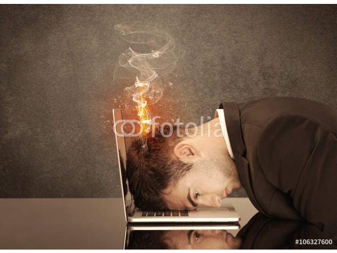 Sad business person's head catching fire 64238