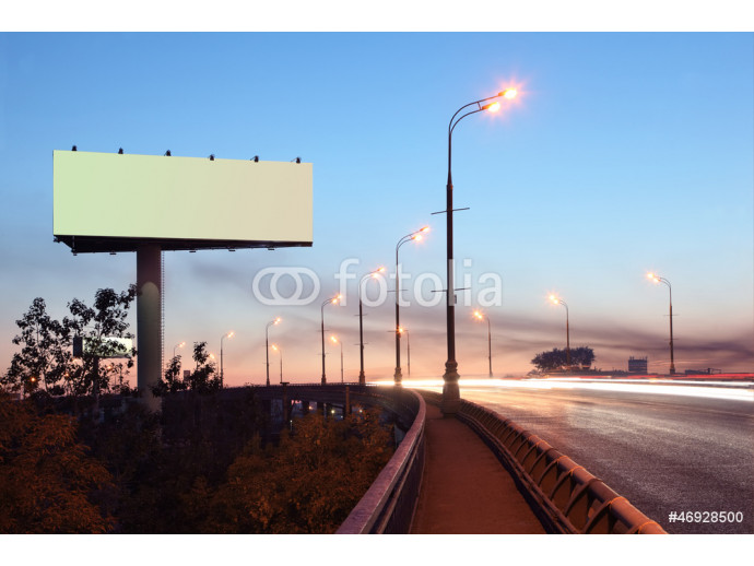 Road with lights and large blank billboard at evening in city. 64238