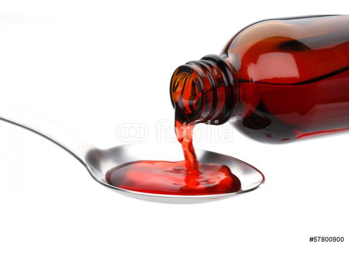 Bottle pouring Medicine Syrup in Spoon 64238