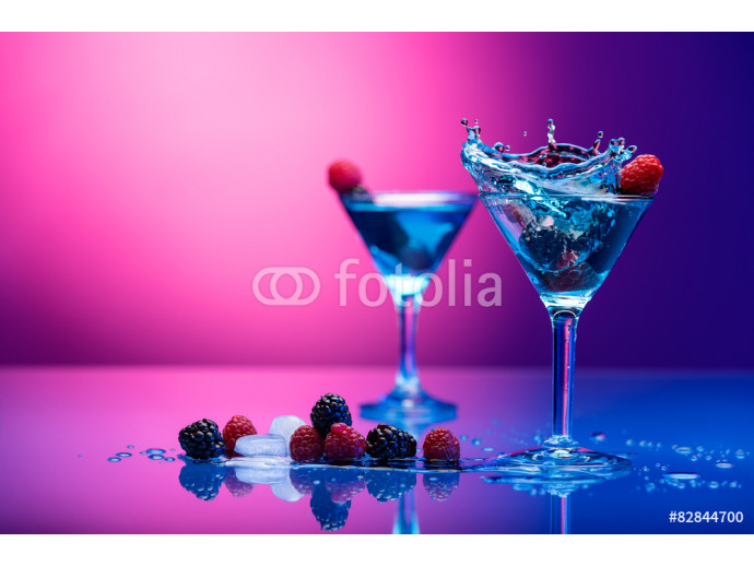 Colorful cocktails garnished with berries 64238