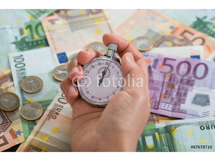 Person Hands With Stopwatch Over Money 64238