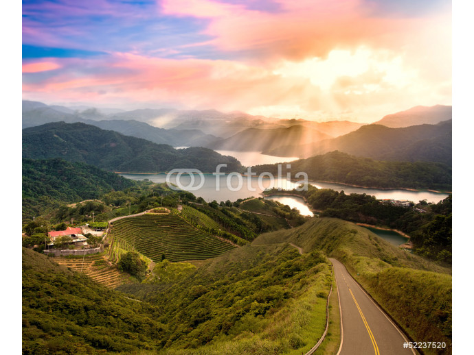Beautiful sunset with green road for adv or others purpose use 64238