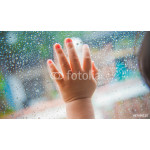 Rain drops on the car window and children hand . Abstract backgr 64238