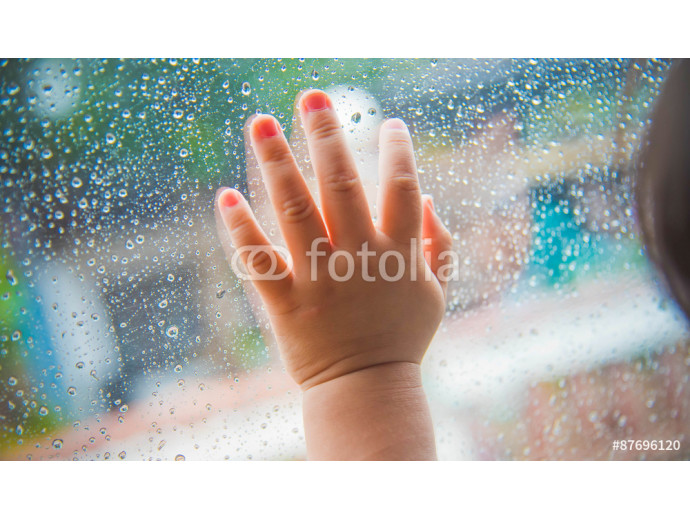 Photo wallpaper Rain drops on the car window and children hand . Abstract backgr 64238