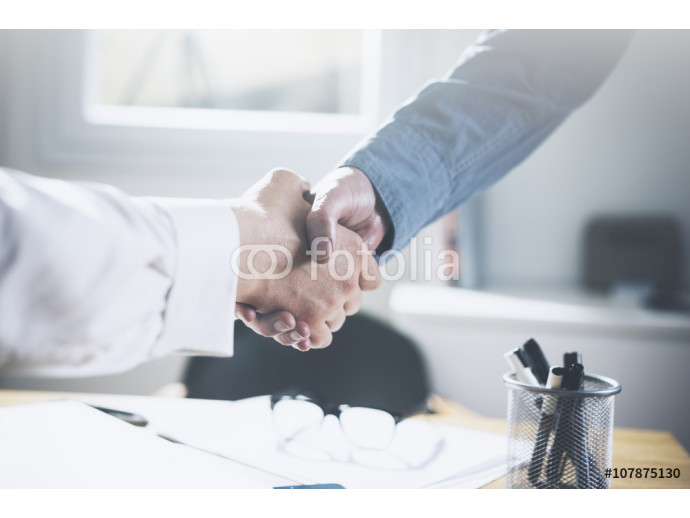 Close up image of business partners making handshake 64238