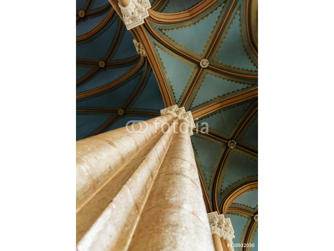 high beige columns and vaulted blue ceiling in the Christian church 64238