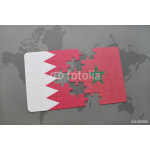 puzzle with the national flag of bahrain and morocco on a world map background. 64238