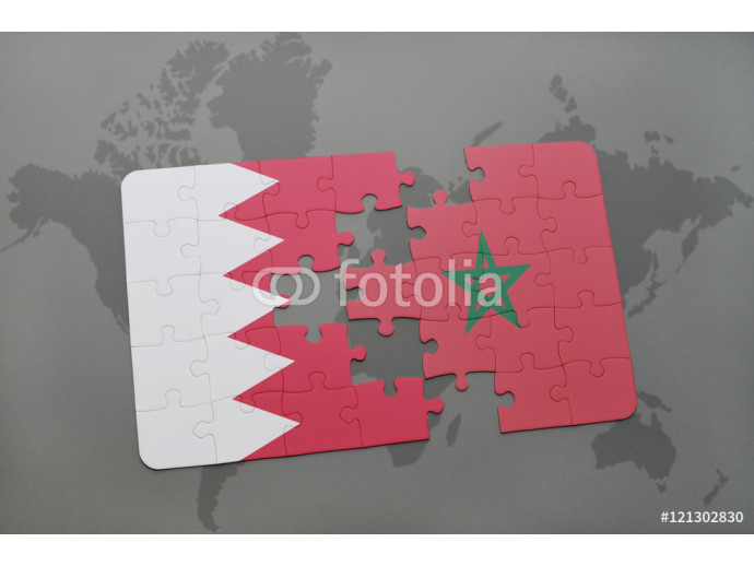 Vliestapete puzzle with the national flag of bahrain and morocco on a world map background. 64238