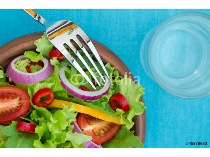 Fresh Salad in a bowl on fabric background 64238