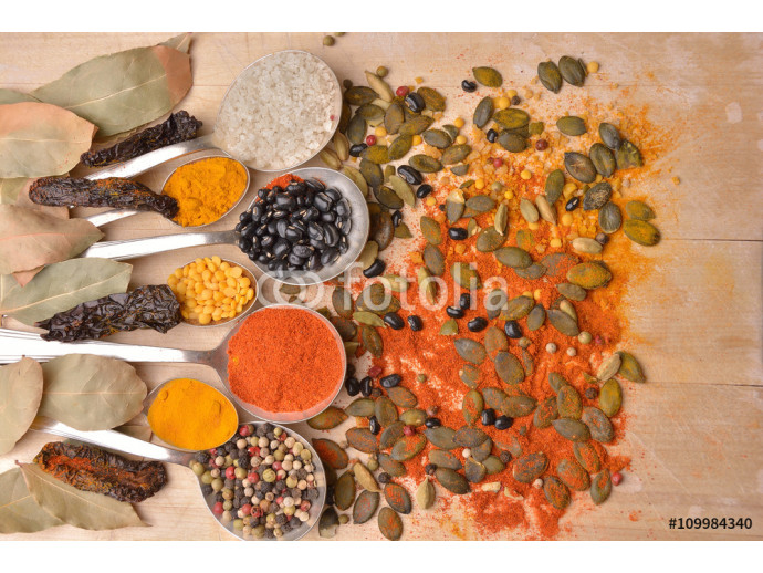 Various colorful spices on wooden table 64238