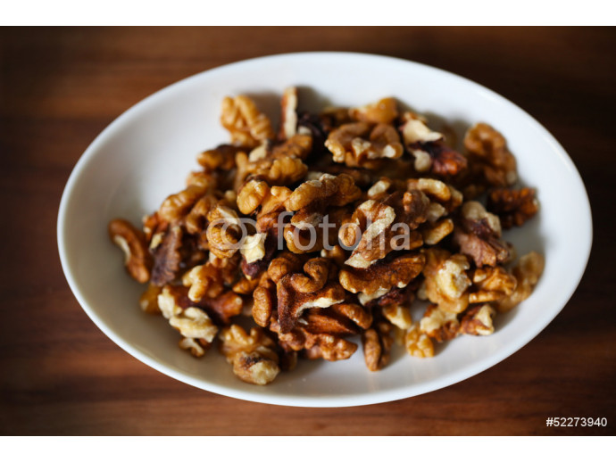 Walnuts, shelled fruit on white plate, food ingredient 64238