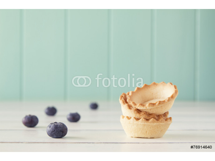 A stack of tartlets and several blueberries. Vintage Style. 64238