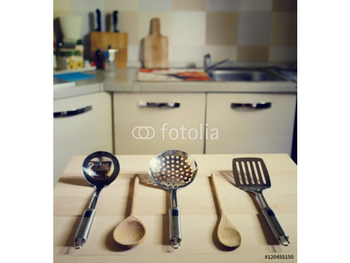 ladles on wooden table on kitchen  background 64238