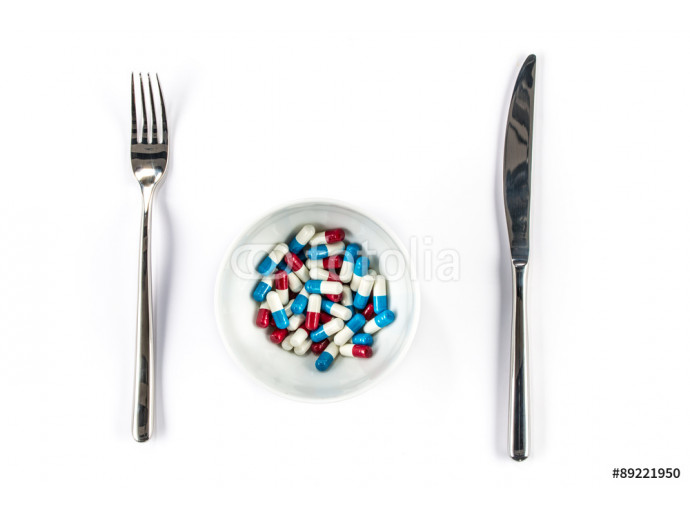 Capsule on bowl with Knife and fork, meal 64238