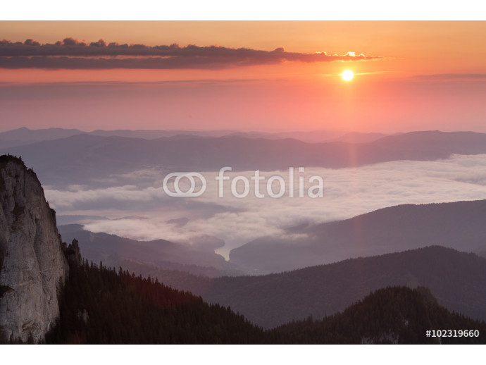 Sunrise over mountains and clouds 64238