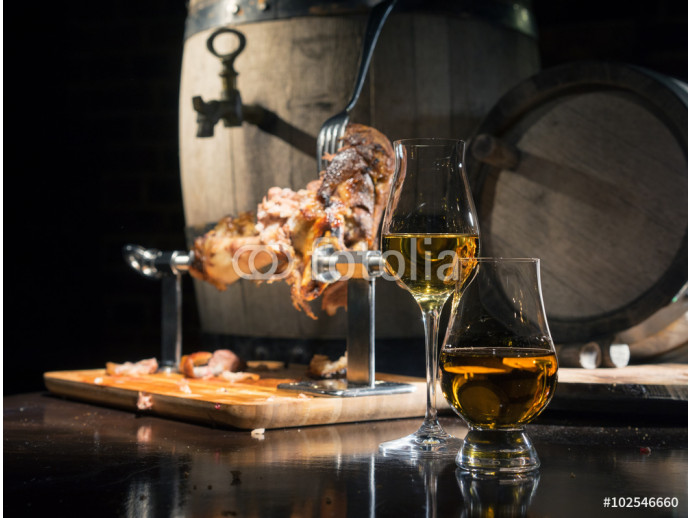 whiskey, cognac, calvados with boiled pork knuckle on the background of oak barrels 64238