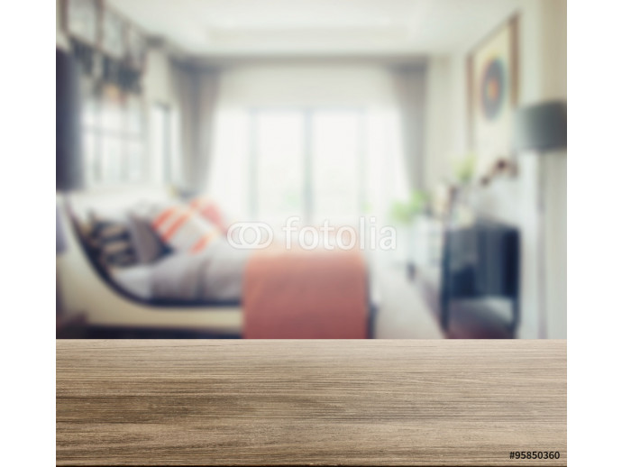 wooden table top with blur of modern bedroom interior 64238