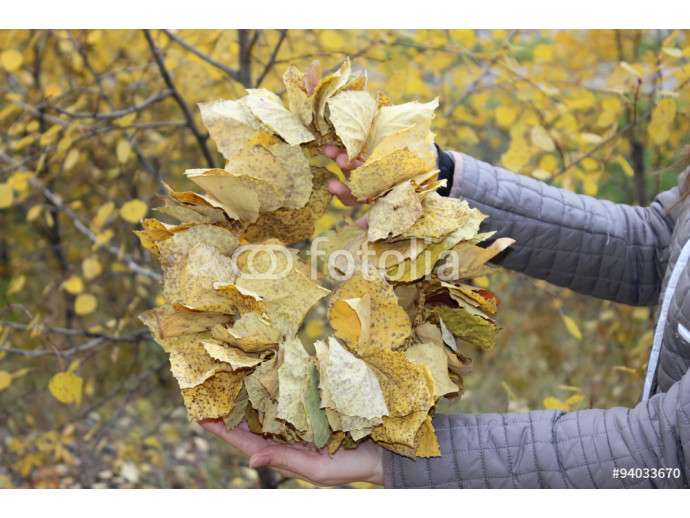 Autumn Wreath in hands at the girl. 64238
