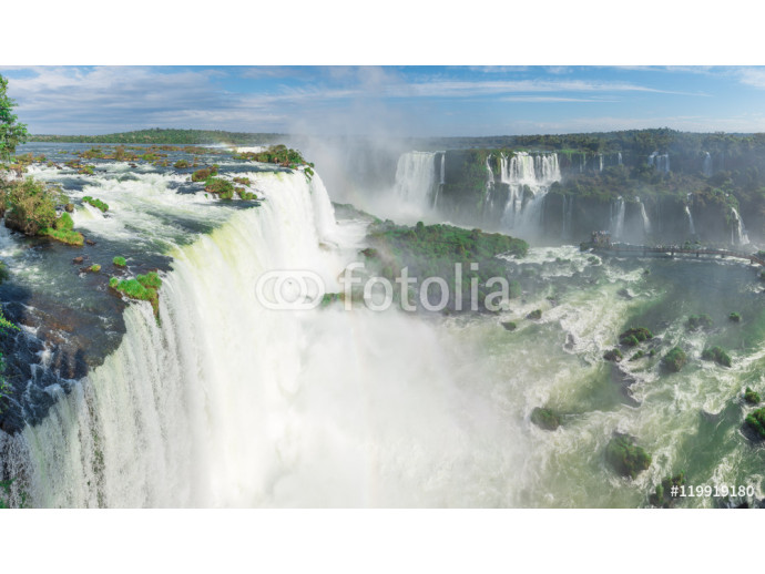 Fotomurale The Iguazu Falls with clouds and blue sky 64238