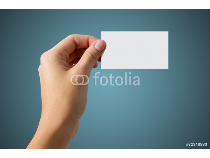 hand holding a business card on a blue background 64238