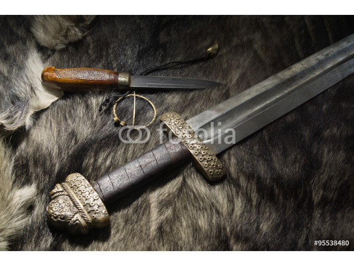 Viking sword and knife on a fur 64238