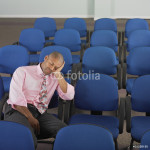 Businessman resting in blue chairs 64238
