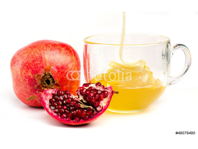 Fototapeta pomegranate and honey in a cup of  glass on white 64238