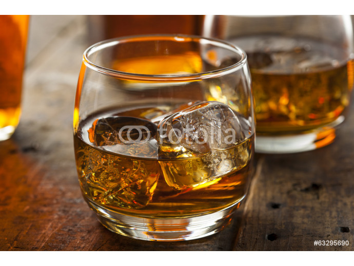 Alcoholic Whiskey Bourbon in a Glass with Ice 64238