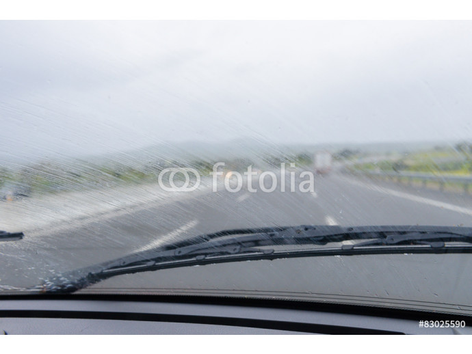 wipers on the windshield of the car in the rain 64238