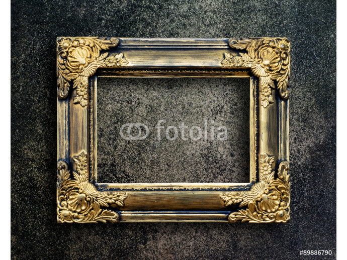 Old picture frame on grunge wall. 64238