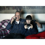 Grandfather and granddaughter watching television 64238