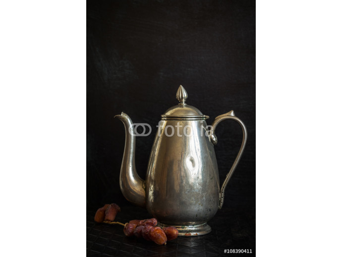 Fototapeta Food background with antique iron kettle and dates. 64238