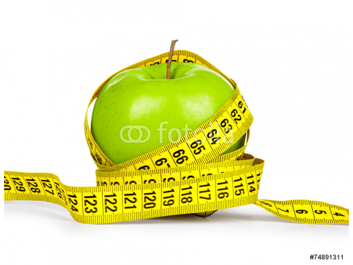 Diet concept. Green apple and yellow measuring tape on an isolat 64238
