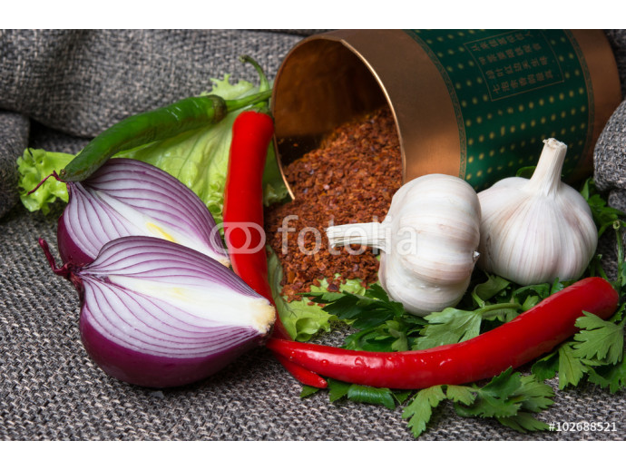 three chili peppers with garlic and fresh herbs 64238