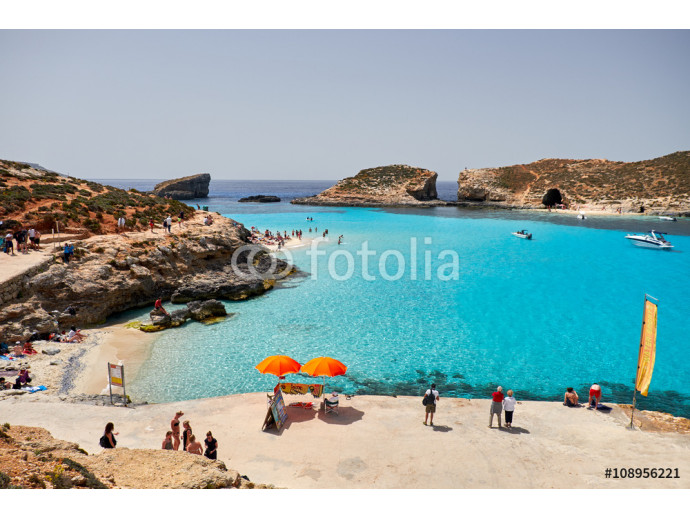 BLUE LAGOON, COMINO, MALTA - APRIL 13, 2016. People enjoy blue lagoon  with crystal clear blue water. 64238