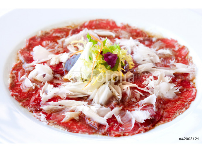 Beef carpaccio with parmesan cheese. 64238
