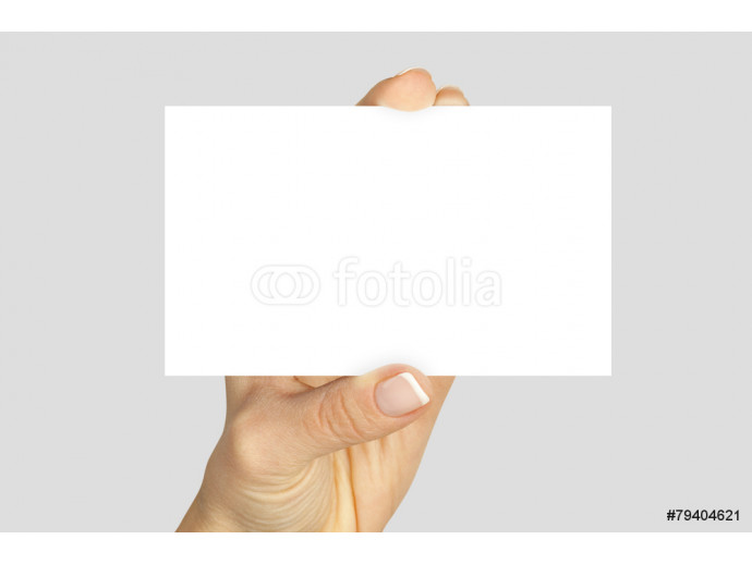 fingers holding a blank card 64238