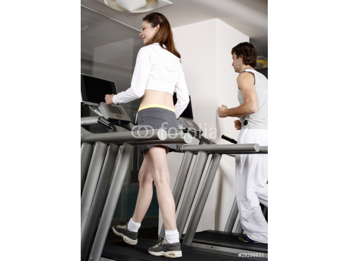 Young woman and man on treadmill 64238
