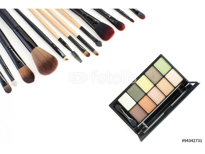 green tone eye shadow kit and professional makeup artist brushes on white background 64238