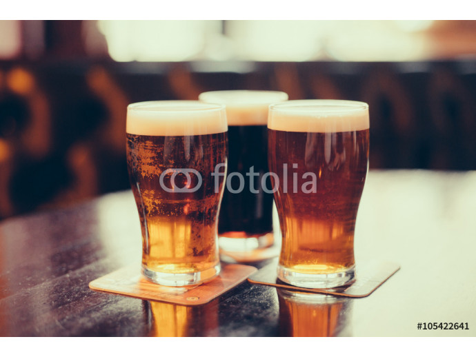 Glasses of light and dark beer on a pub background. 64238