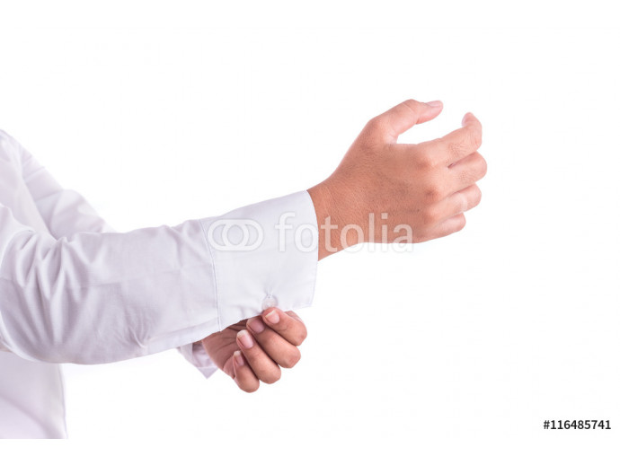 Hand of woman holding cufflinks isolated on white background 64238