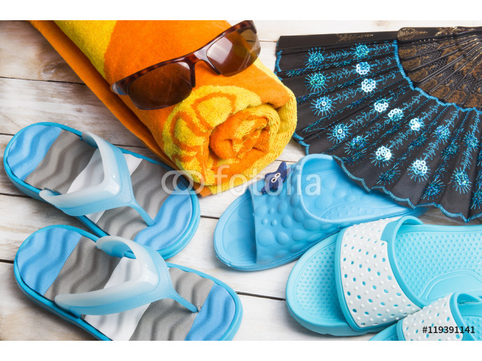 Pair of blue slippers and orange towel on wood. Vacation in summer 64238