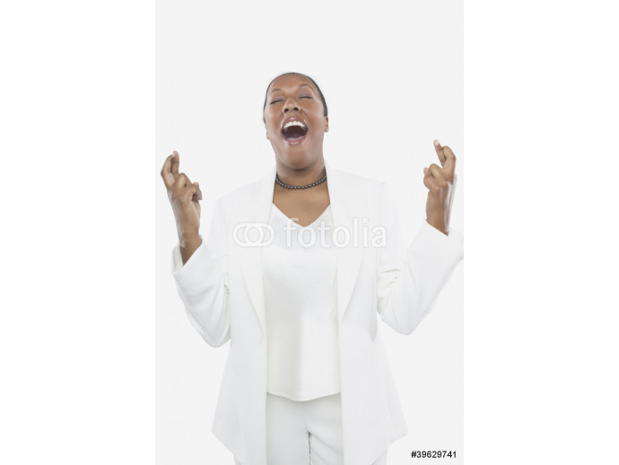Studio shot of African woman with her fingers crossed 64238