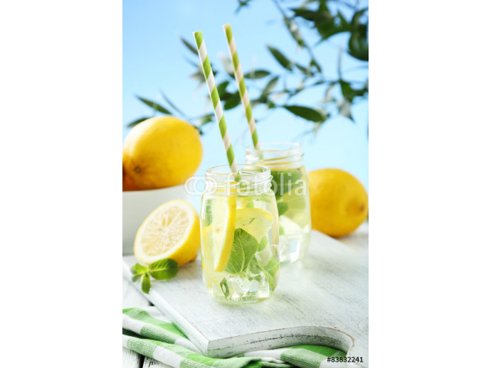 Fresh lemonade with lemon on white wooden background 64238