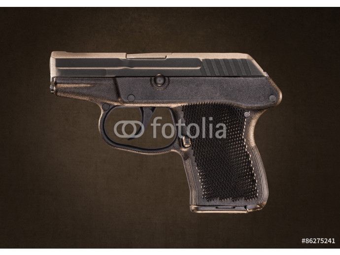Keltec P-32 Pocket Pistol Gun isolated on Gray Grundge Backgroun 64238