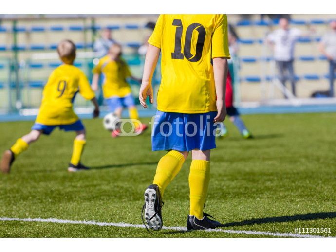 Wallpaper Young boys playing football soccer game on soccer pitch 64238