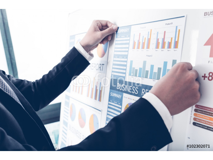 Businessman analyzing investment charts. Accounting 64238