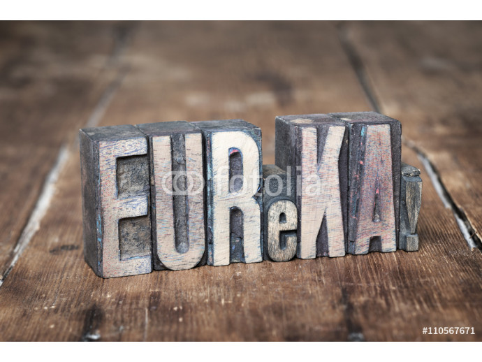 eureka exclamation made from wooden letterpress type on grunge wood 64238