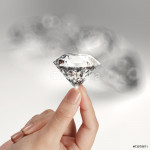 hand holding 3d diamond over grey background 64238