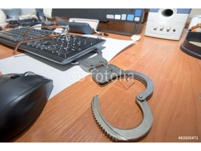 Handcuffs open paper clip on the table office worker 64238